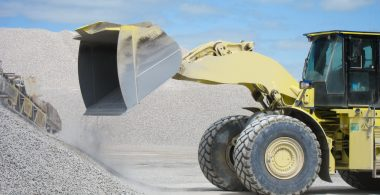 Photo of loader pouring stone in the quarry